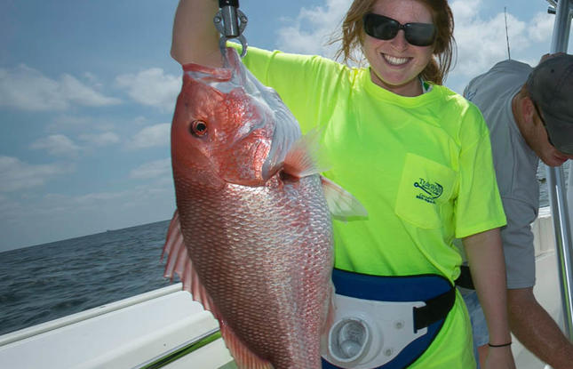 Girl catches red snapper - deep sea fishing louisiana