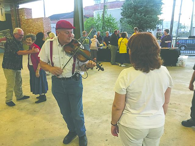 Cajun dancing and Cajun food are highlights of the Saturday night party Photo