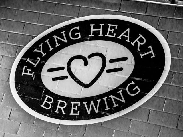Flying Heart logo on brewery wall.