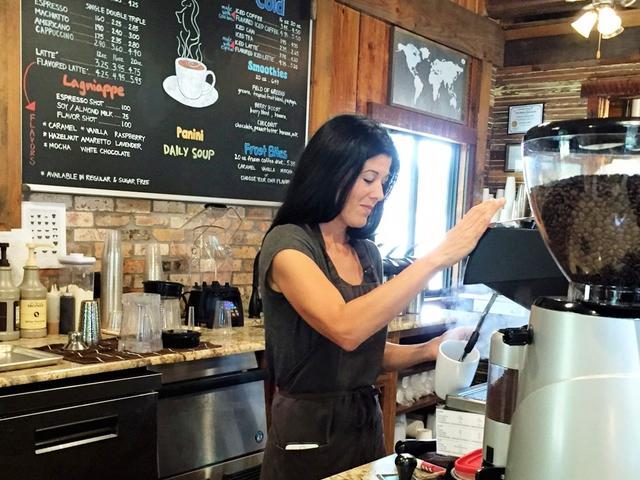 Giddy Up owner Ashley Belanger makes a customer's coffee.