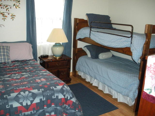 The second bedroom of the cabin has a full sized bed and a set of bunk beds.  The cabin is great from small families or up to 4 fishermen.