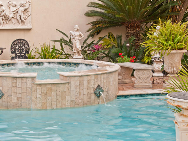 Relax in our Roman-styled hot tub and pool set in a lush tropical garden