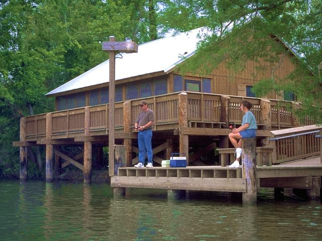 Fishing from one of the lakefront cabins at Lake Fausse Pointe State Park. Photo 2