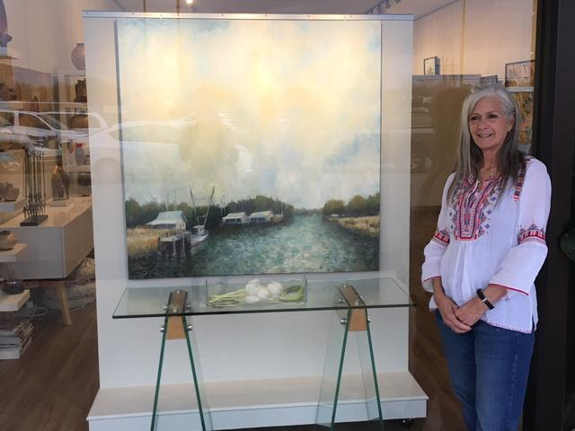 Kathy Biedenharn, Owner I Levee Gallery with Dr. Charles Guess Painting Photo