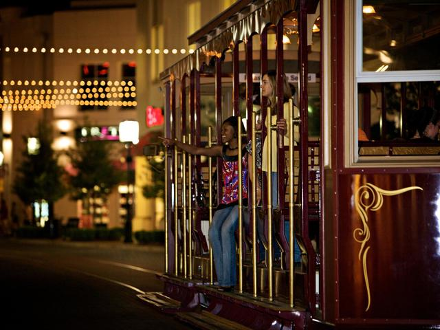 The Magnolia Belle Trolley at the Outlets at the Louisiana Boardwalk wisk visitors throughout the property.