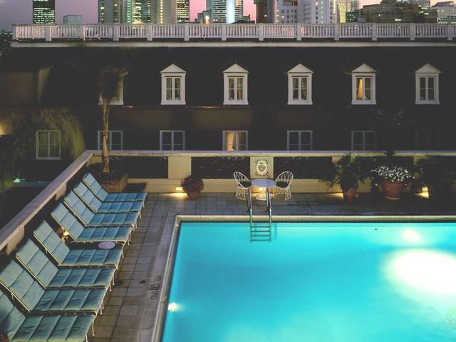 Night time view of heated roof top Salt water pool Photo 5