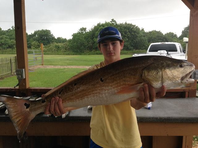 One happy customer with a big Redfish