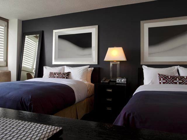 Unwind in one of our Wonderful Rooms featuring exclusive W signature bed.