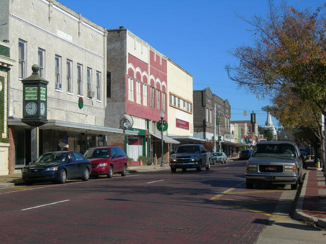 Original red brick streets in historic downtown Minden. Photo 3