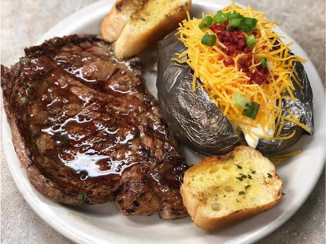 14 ounce Rib Eye Steak with a loaded baked potato